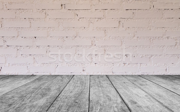 Stock photo: Black and white wooden table top with brick wall