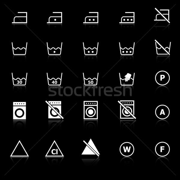 Laundry icons with reflect on black background Stock photo © punsayaporn