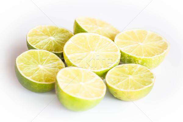 Fresh citrus lime half portion slice on white background Stock photo © punsayaporn