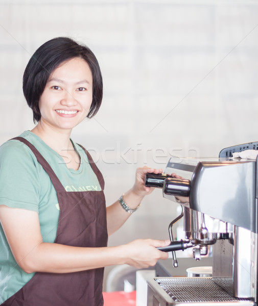 Woman barista at work in coffee shop Stock photo © punsayaporn