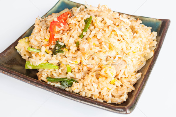 Fried rice with deep fried pork garlic and vegetable Stock photo © punsayaporn