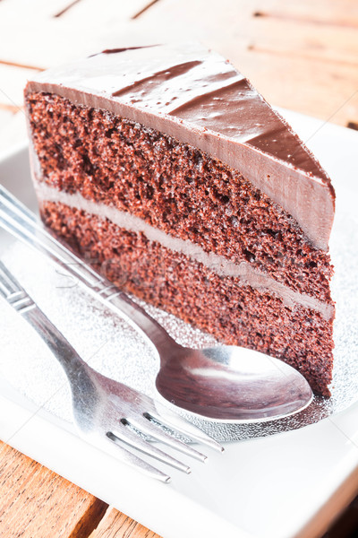 Piece of chocolate cake serving with spoon and fork  Stock photo © punsayaporn