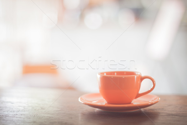 Mini orange coffee cup on wooden table Stock photo © punsayaporn