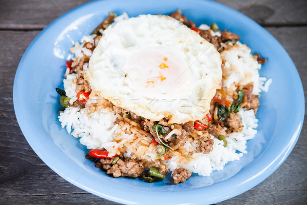Thai spicy food, rice topped with stir fried pork and basil with Stock photo © punsayaporn