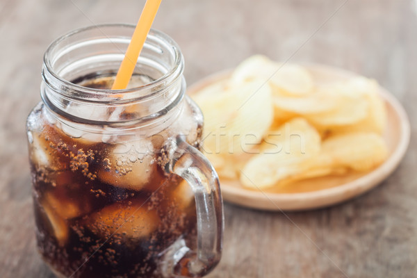 Iced cola with potato chips Stock photo © punsayaporn