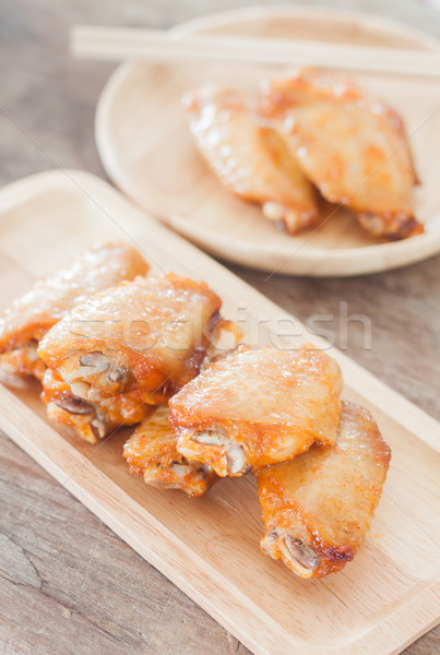 Grilled chicken wings on wooden plate Stock photo © punsayaporn