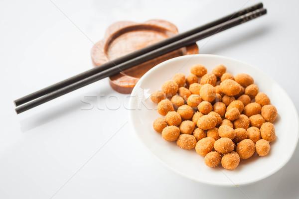 Erdnüsse Snack würzig Würze Essstäbchen Textur Stock foto © punsayaporn