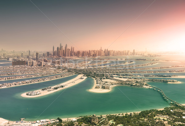 Dubai skyline from Palm Island at sunset Stock photo © PureSolution