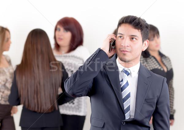 Hispanic man using a cellphone with peers Stock photo © pxhidalgo