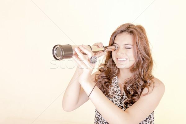 Young woman using telescope Stock photo © pxhidalgo