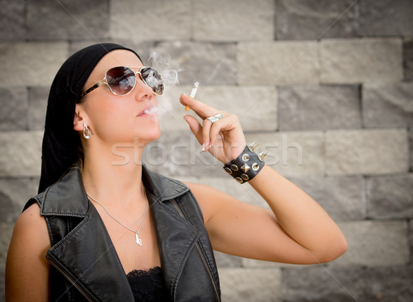 gang woman smokes on the street, selective focus Stock photo © pxhidalgo