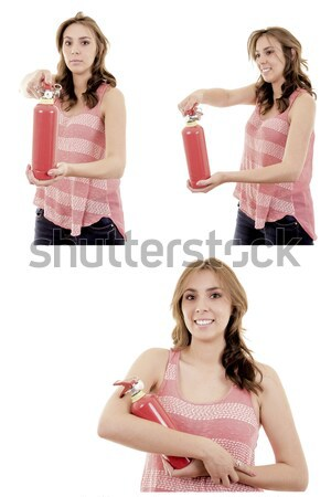 beautiful young businesswoman, using a fire extinguisher isolated on white Stock photo © pxhidalgo