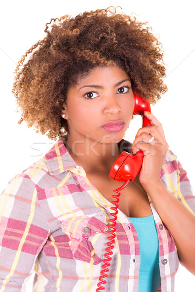 Portrait of a pretty black young woman talking on phone Stock photo © pxhidalgo