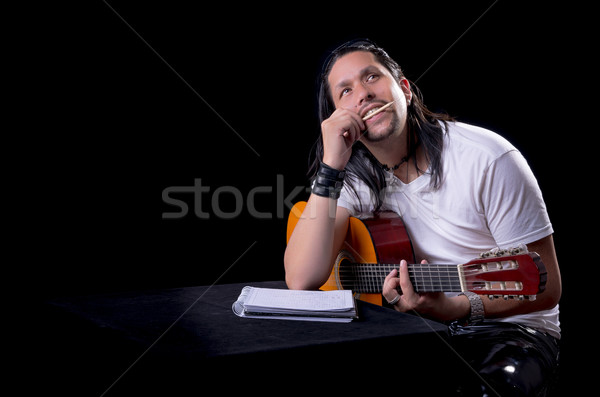 Guitarist musician writing a song on his guitar Stock photo © pxhidalgo