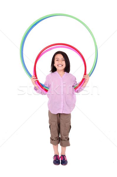Jong meisje spelen hoelahoep geïsoleerd witte meisje Stockfoto © pxhidalgo