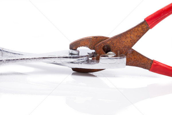 rusty pliers biting shiny ones Stock photo © pxhidalgo