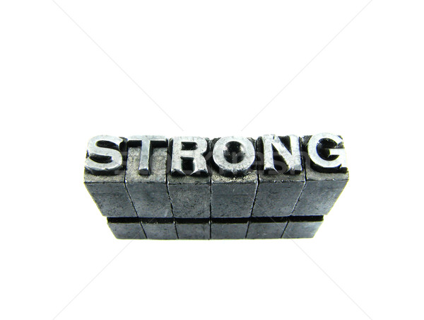 STRONG sign, antique metal letter type isolated Stock photo © pxhidalgo