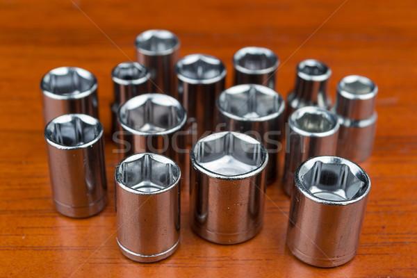 Set of chromeplated wrench dadoes, on wood Stock photo © pxhidalgo