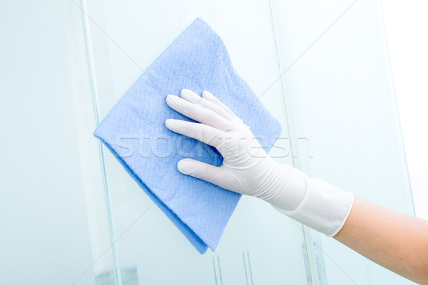 Hand and glove  with blue sponge cleaning glass Stock photo © pxhidalgo
