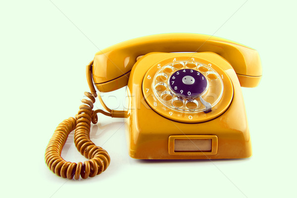 old Orange telephone with rotary dial Stock photo © pxhidalgo