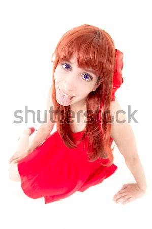 Young woman in red dress with tongue out Stock photo © pxhidalgo