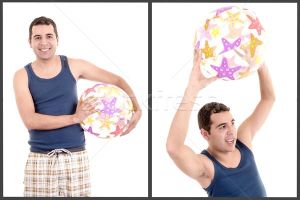 Mosolyog fiatalember strandlabda tengerpart férfi boldog Stock fotó © pxhidalgo