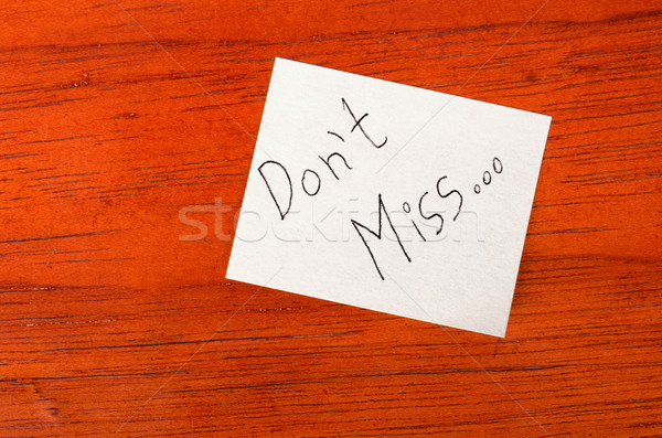 Dont Miss - Post it Note on Wood Background Stock photo © pxhidalgo