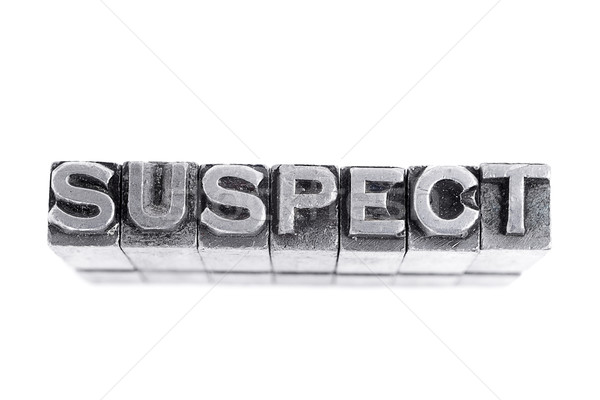 Suspect sign, antique metal letter type Stock photo © pxhidalgo