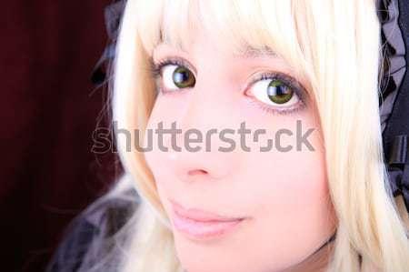 Fiatal szőke nő visel szín kontaktlencsék néz Stock fotó © pxhidalgo