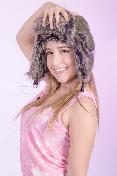 Hapy girl in fur cap and pink background Stock photo © pxhidalgo