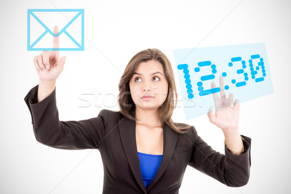 businesswoman touching virtual screen with charts and time Stock photo © pxhidalgo