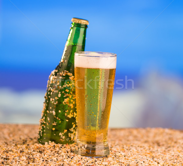Ice cold green unlabelled bottle of beer in the beach concept Stock photo © pxhidalgo