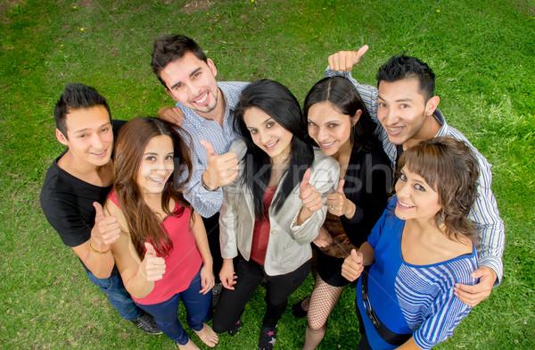 Group of teens thumbing up outdoors Stock photo © pxhidalgo