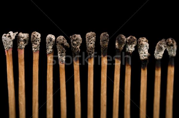 New and burnt matches, close-up, black background Stock photo © pxhidalgo