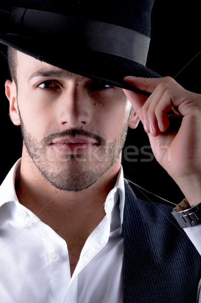 Hhandsome young man with a hat black background Stock photo © pxhidalgo