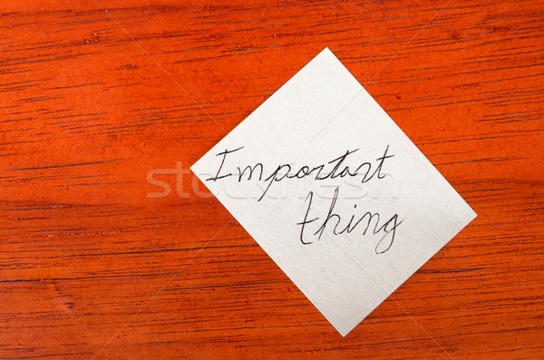 Important thing- Post it Note on Wood Background Stock photo © pxhidalgo