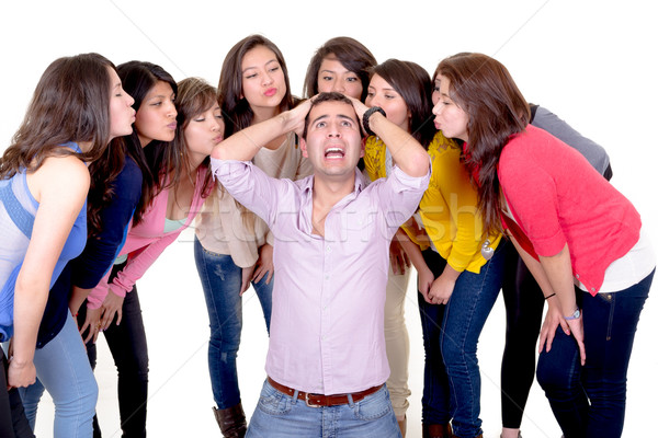 Eight Girls kissing a stressed man Stock photo © pxhidalgo