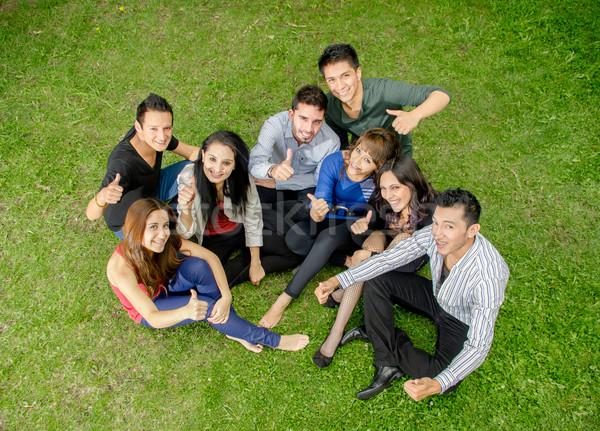 Group of hispanic teens thumbing up outdoors Stock photo © pxhidalgo
