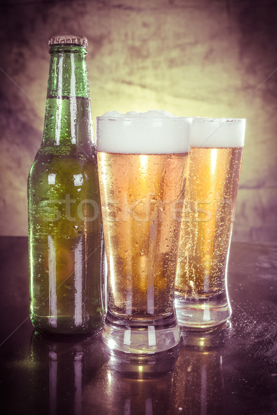 Glasses of beer with green bottle color processed Stock photo © pxhidalgo