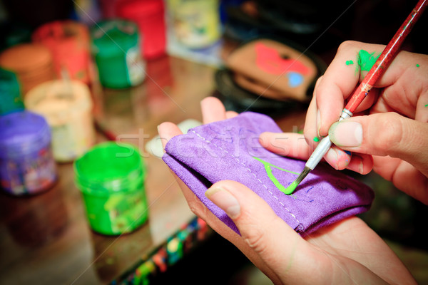 hand painting a wallet with paintbrush Stock photo © pxhidalgo