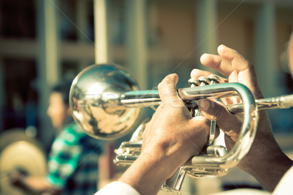 Stock photo: street band playing, selective focus on the hands with trumpet