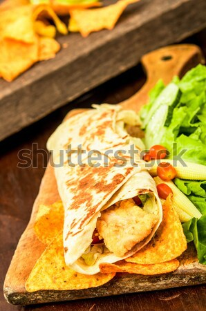 Chicken wrap burrito served on a wooden plate Stock photo © pxhidalgo