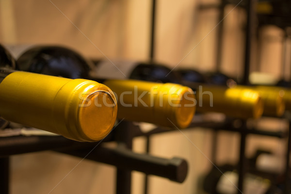 Wine bottles stacked on racks Stock photo © pxhidalgo