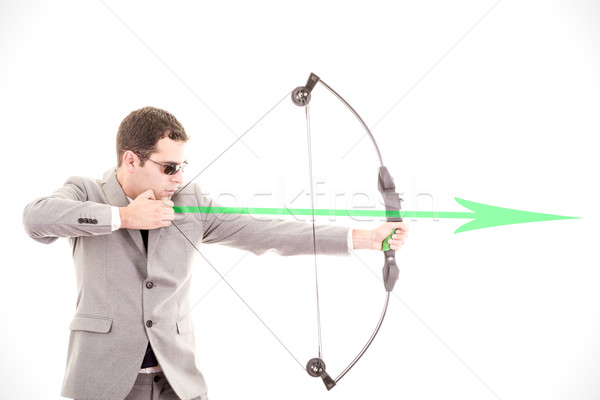 Determined businessman aiming at target, bow and arrow Stock photo © pxhidalgo