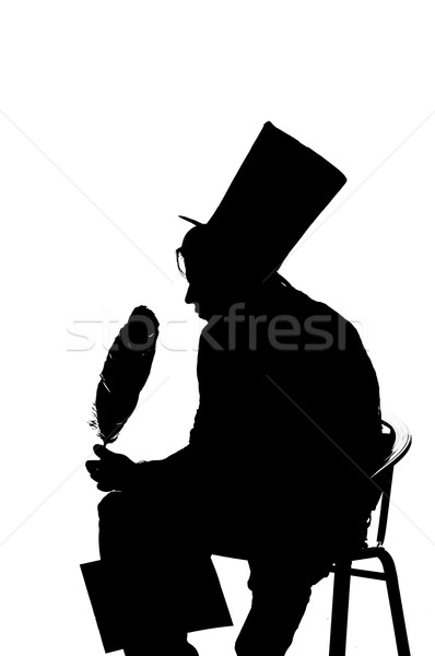 silhouette man sitting on a stool while writing Stock photo © pxhidalgo