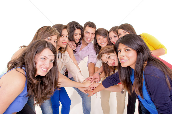 Teamwork: Group of diverse people joining hands Stock photo © pxhidalgo