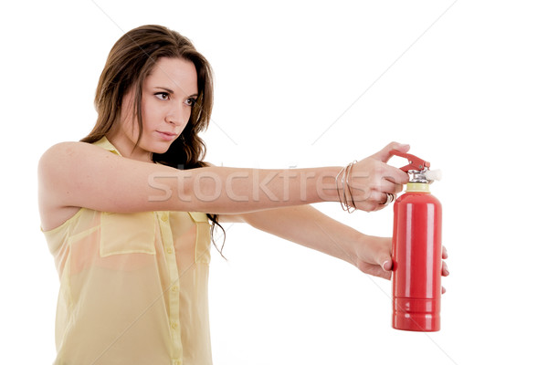 The image of young woman with extinguisher on white Stock photo © pxhidalgo