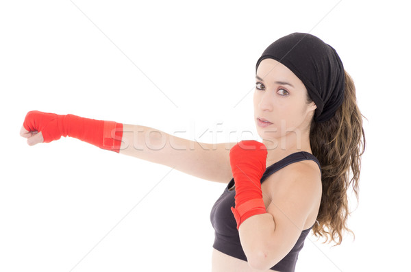 Female mixed martial arts fighter in MMA style gloves strikes a fight stance Stock photo © pxhidalgo