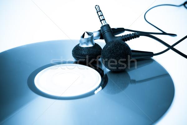 Audio headphones with CD blue tone Stock photo © pxhidalgo
