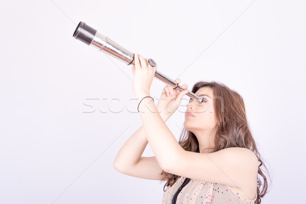 Young woman using telescope Stock photo © pxhidalgo